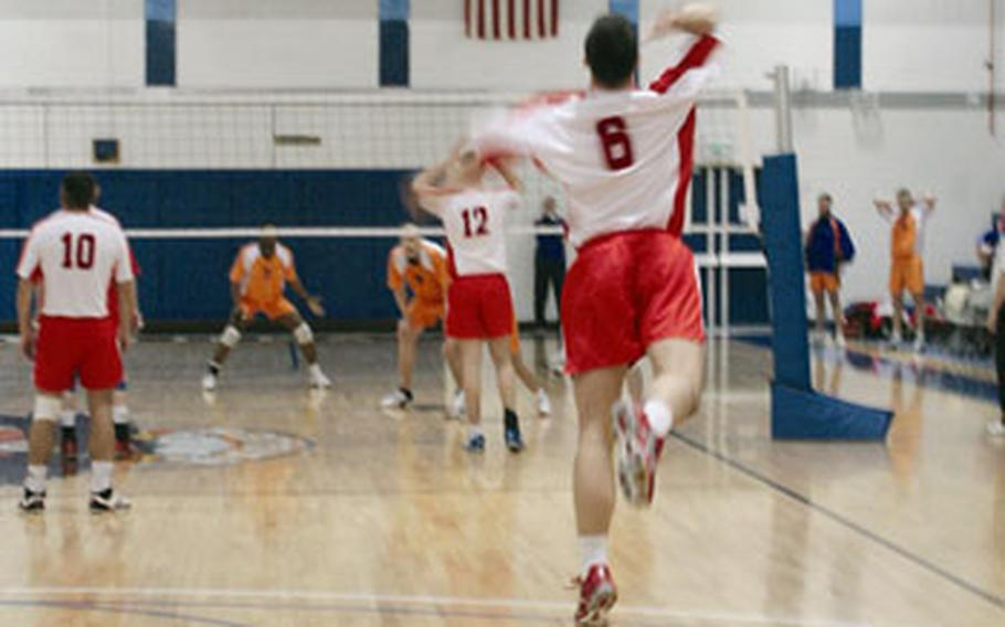 A member of the Polish men's volleyball team serves during the men's championship match against the Dutch in the 5th Allied Air Component Command tournament last week at RAF Lakenheath. The Dutch won and claimed the men's title.