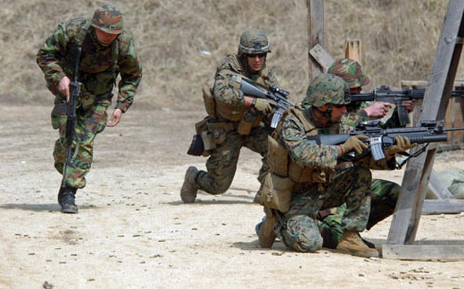 U.S. Marines and their S. Korean counterparts practice fire and maneuver techniques.