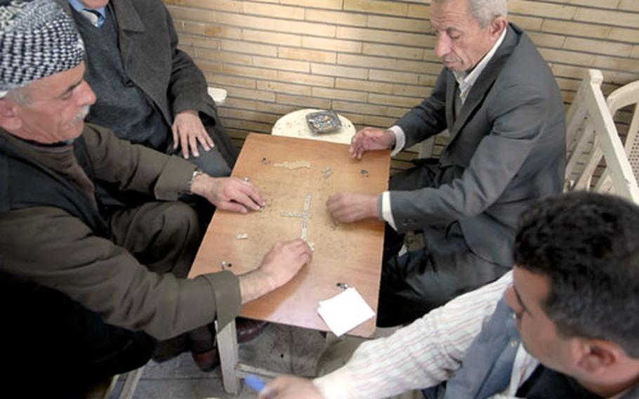 Men play dominoes at one of Irbil's ubiquitous tea shops, many abuzz with political chatter. Many Kurds say they are deeply concerned about their future and are critical of both the Arab-dominated central government and Kurdistan's semi-autonomous regional government.
