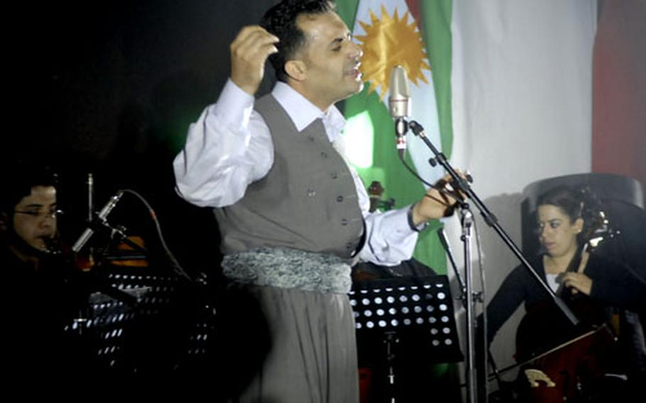 A Kurdish singer belts out a mournful tune during a memorial ceremony in Halabja commemorating a 1988 chemical attack by Saddam Hussein's forces on that town and surrounding areas that killed as many as 5,000 people.