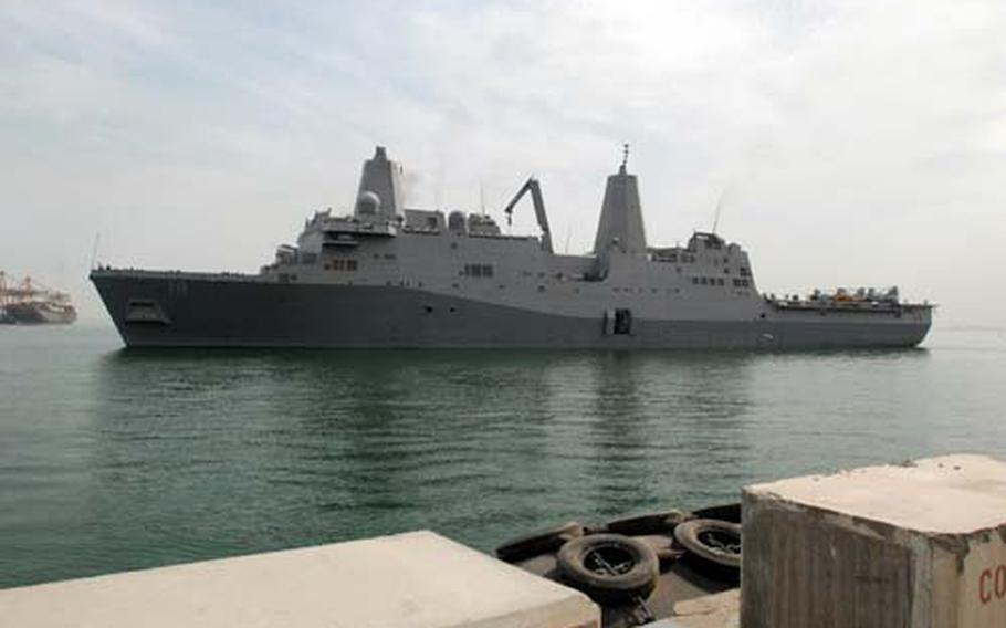 The USS New Orleans, which collided with the fast-attack nuclear submarine USS Hartford in the Strait of Hormuz on Friday, pulls into Mina Salman pier in Bahrain on Saturday. U.S. Navy engineers and inspection teams will assess and evaluate damage to the New Orleans and Hartford, which also arrived Saturday in Bahrain.