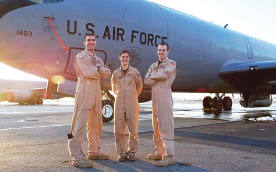 Capt. Matthew Jaeger, left, Senior Airman Mckayla Dick, center, and 1st Lt. Vance Feavel stand by the KC-135 Stratotanker they safely landed after a malfunction using GPS. They were on a refueling mission earlier this month from Manas Air Base, Kyrgyzstan.