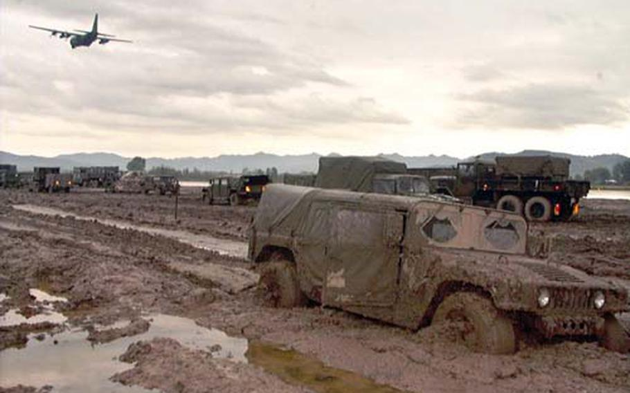 A Humvee is mired in the mud at Task Force Hawk in Tirana, Albania, in 1999. Two weeks into the deployment, the base camp was beginning to show signs of improvement, but the mud still wreaked havoc for those on the ground. In the end, the Germany-based task force and its fleet of 48 AH-64 attack helicopters never saw combat.
