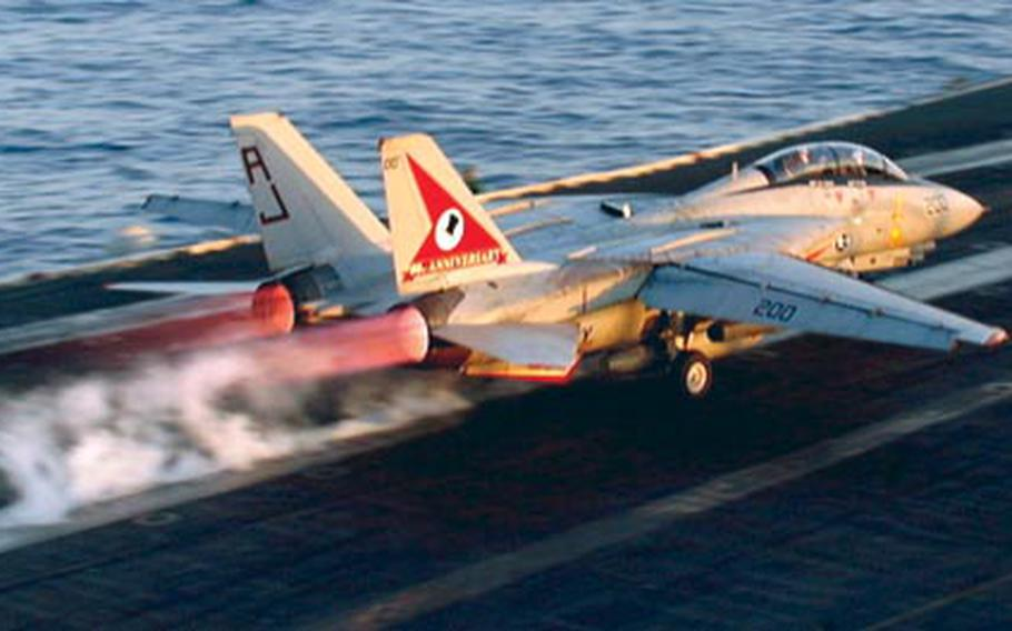 An F-14 Tomcat screams off the aircraft carrier USS Theodore Roosevelt during flight operations on May 15, 1999. Fighters from the Roosevelt were attacking military sites inside Kosovo.