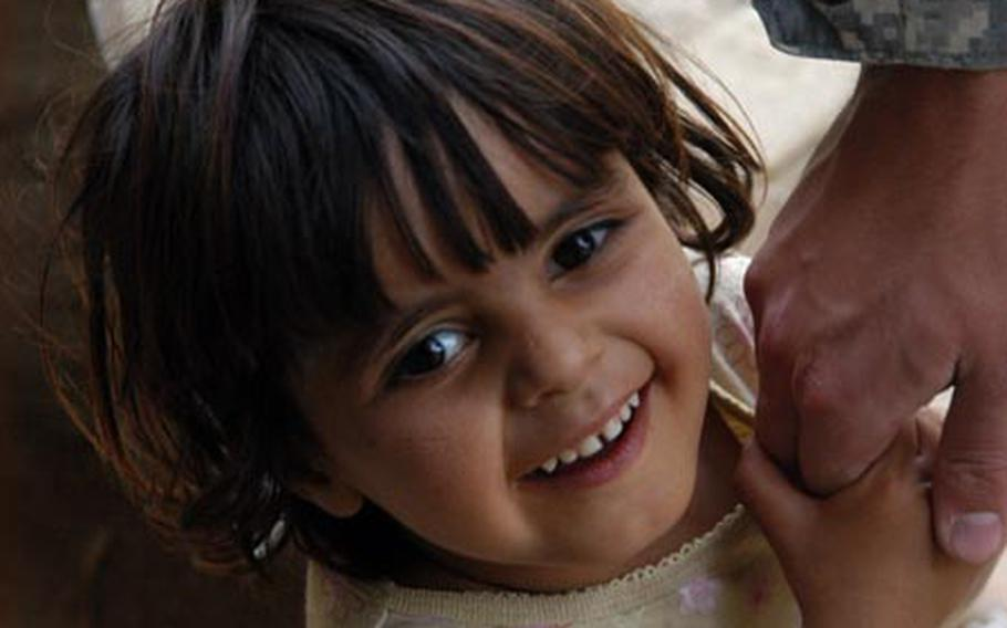 Maryam, 3, a girl who 's family has lived in the Green Zone since 2004, lights up whenever U.S. troops like Airman 1st Class Jonathan Schnaible of the green zone police visit. Through different deployments, U.S. personnel have provided Maryam's family with water, toys and other items. Maryam's mother is heartened by the improved security in Baghdad but nervous about what will happen when the U.S. forces leave as the U.S.-Iraq Security Agreement continues to be implemented.