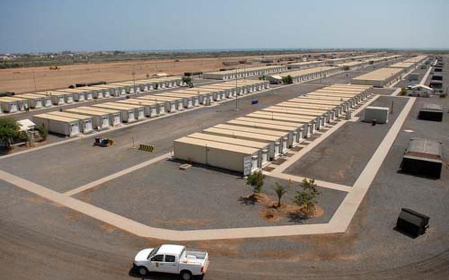 Rows of containerized living units, or CLUs, stretch into the distance March 15 at Camp Lemonier, Djibouti. Troops assigned to the camp lived in climate-controlled tents until workers installed the CLUs, but leaders are already discussing the possibility of building permanent barracks.