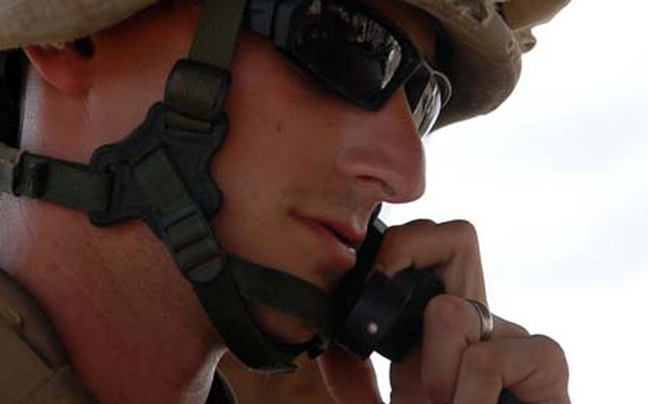 Marine Cpl. Jordan Freybler, a fire team leader, answers a radio call while on guard duty March 20 at Camp Lemonier, Djibouti. The creation of U.S. Africa Command has led the base to become a key installation for areas beyond the Horn of Africa region where it sits.
