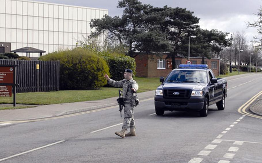 An airman directs traffic during the scare. Several nearby buildings, including the commissary, were evacuated as a precaution. The commissary parking lot and other parts of the base were also blocked off.