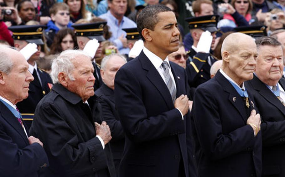 President Obama stands with Medal of Honor recipients (from left) Capt. Thomas J. Hudner, Jr., Lt. John W. Finn, Col. Robert L. Howard and Col. Joe M. Jackson during the playing of Taps at Wednesday's National Medal of Honor Day wreath-laying at Arlington National Cemetery. For more photos, see the link at the top of the story.