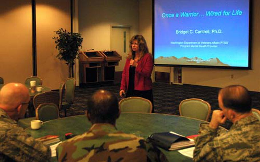 Dr. Bridget C. Cantrell, a licensed mental health counselor specializing in post-traumatic stress disorder, conducts a workshop on recognizing the signs of stress at the Yokota Air Base, Japan, Enlisted Club on Thursday.