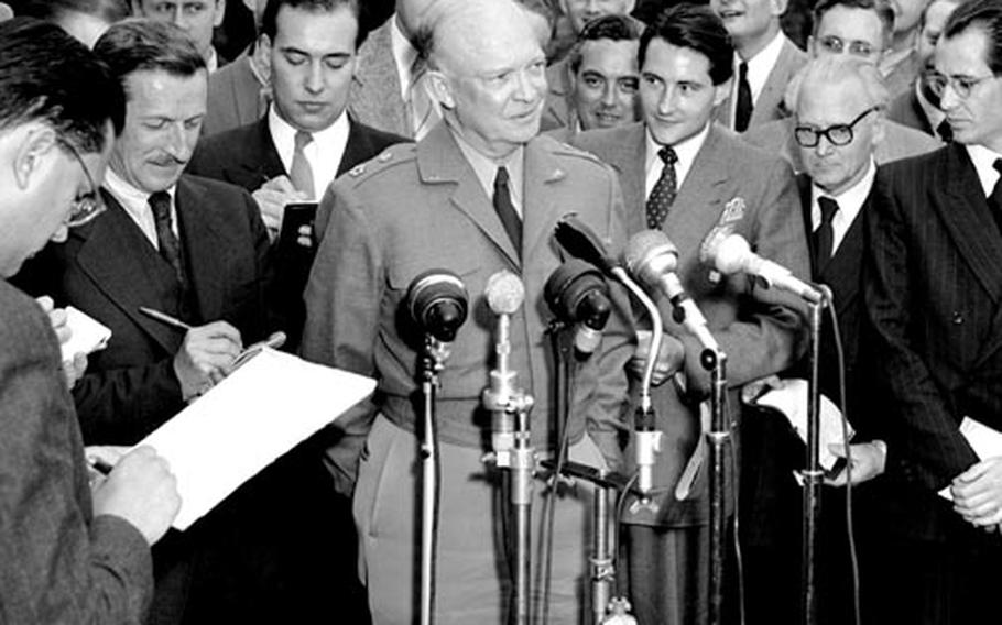 Gen. Eisenhower talks to reporters after his meeting with Chancellor Adenauer.