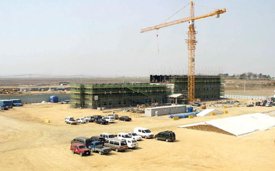 Six eight-story barracks rise at Camp Humphreys in April 2009 as part of the post's expansion to become the U.S. military's main installation in South Korea.
