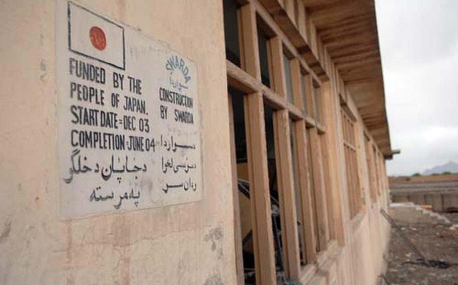 A sign on a former school hints at the hopes the area once had for educating children. This building is now a National Police checkpoint.