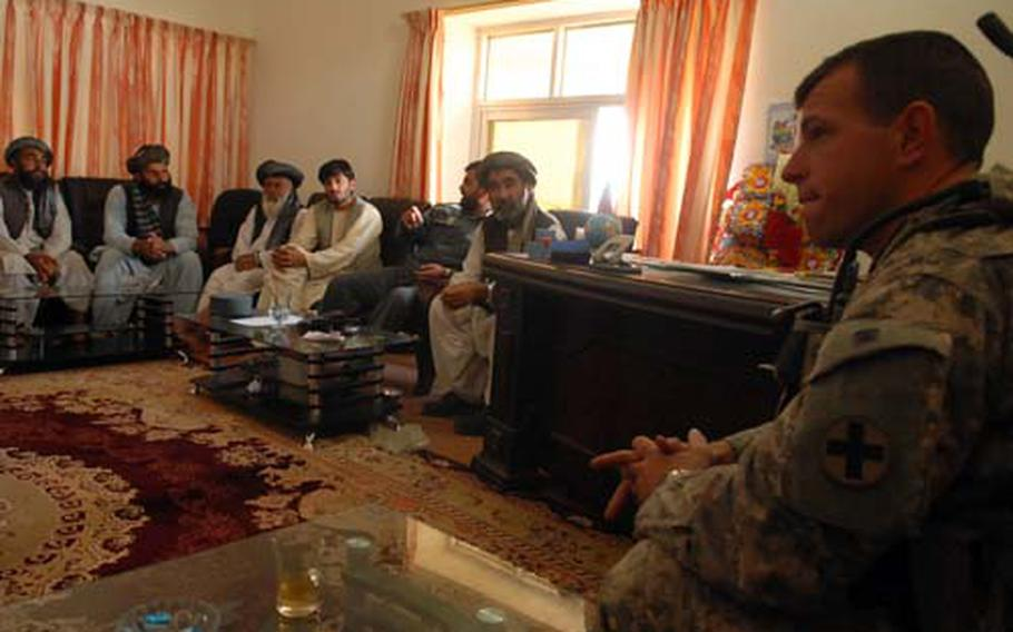 Capt. Kenton Patrick, police mentoring team leader for the Arghandab district, talks to village elders Thursday at a weekly shura, or council, in Baba Shabdoray, Afghanistan.