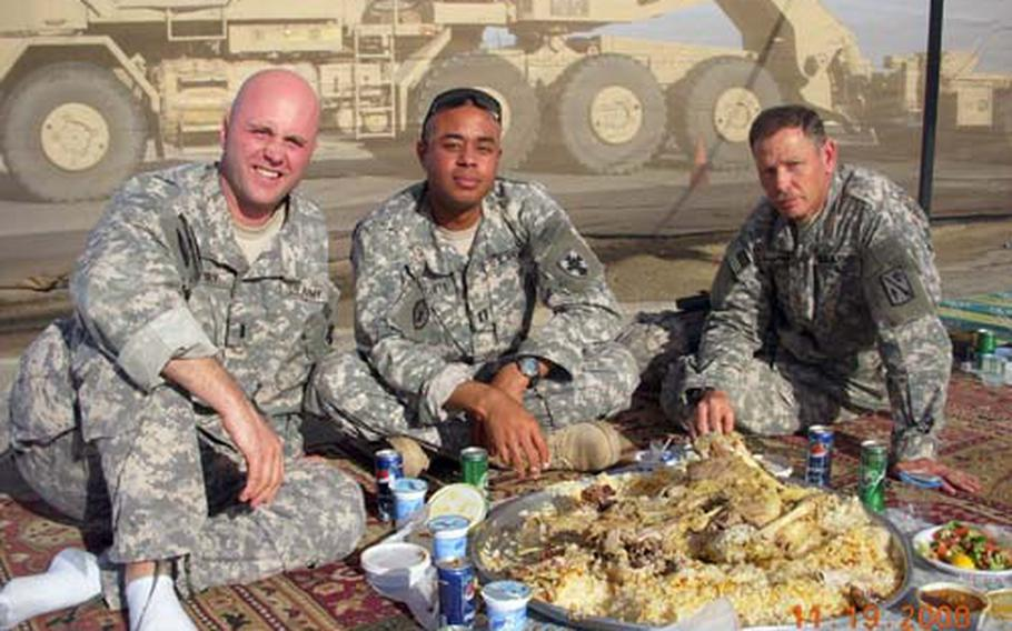 Soldiers enjoy a traditional Kuwaiti lunch at K-Crossing on the Kuwait-Iraq border. The 623rd is the first U.S. Army unit to deploy from Japan to Southwest Asia.