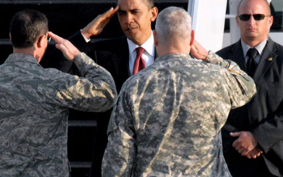 President Obama returns the salutes of Gen. Carter Ham, center, and Maj. Gen. Marc Rogers, left, before boarding Air Force One.