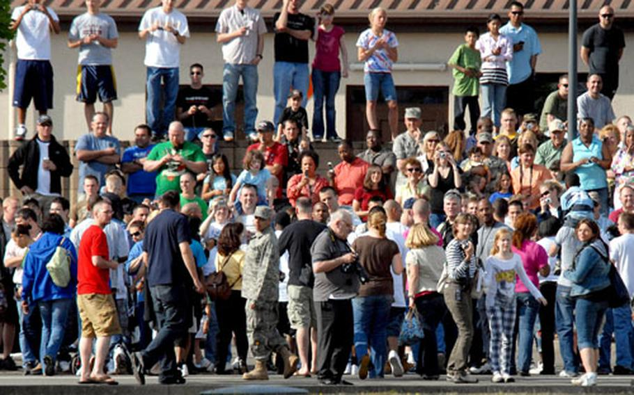 Part of the crowd hoping for a glimpse of President Obama on a Ramstein Air Base street Friday.