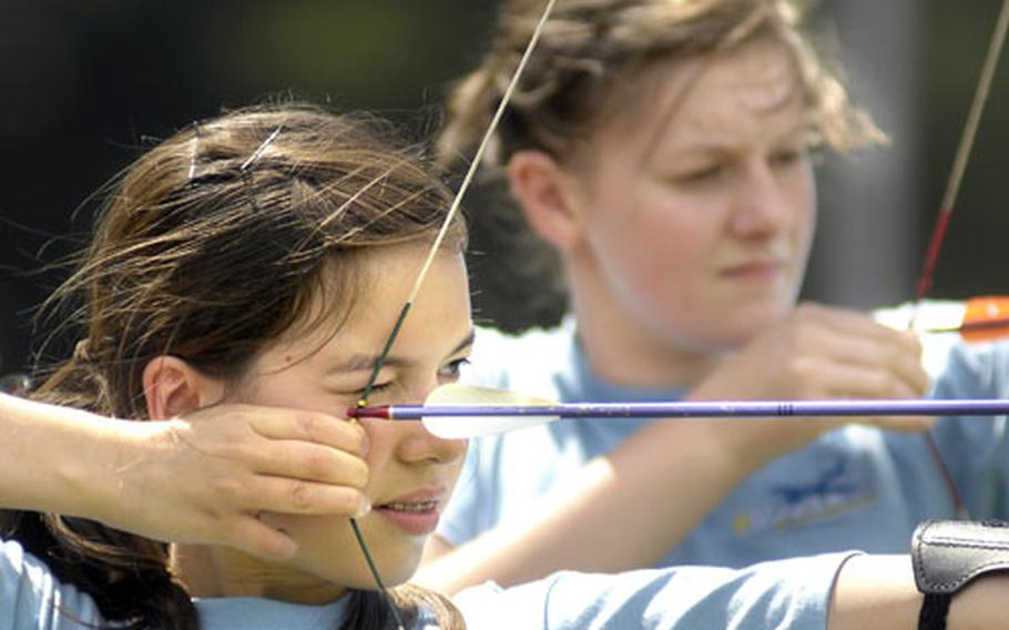 Cadet Lizzy Tan hones her archery skills Wednesday afternoon at the Rod and Gun Club in Vogelweh.