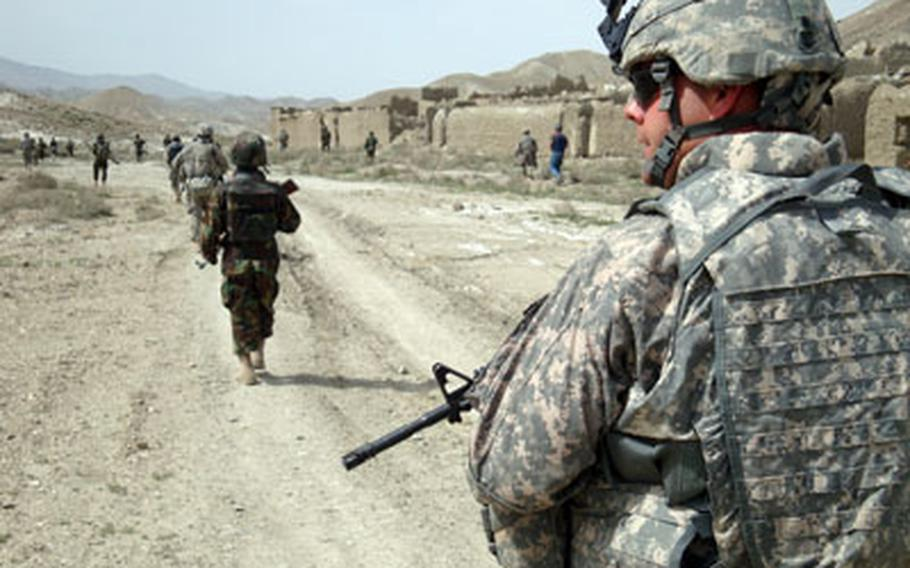 Spc. William Bolling, a chaplain's assistant, walks on patrol in April with the Afghan Border Police's 2nd kandak (battalion) in Chamkani, Paktia province. U.S. soldiers are training the border police in basic tactics