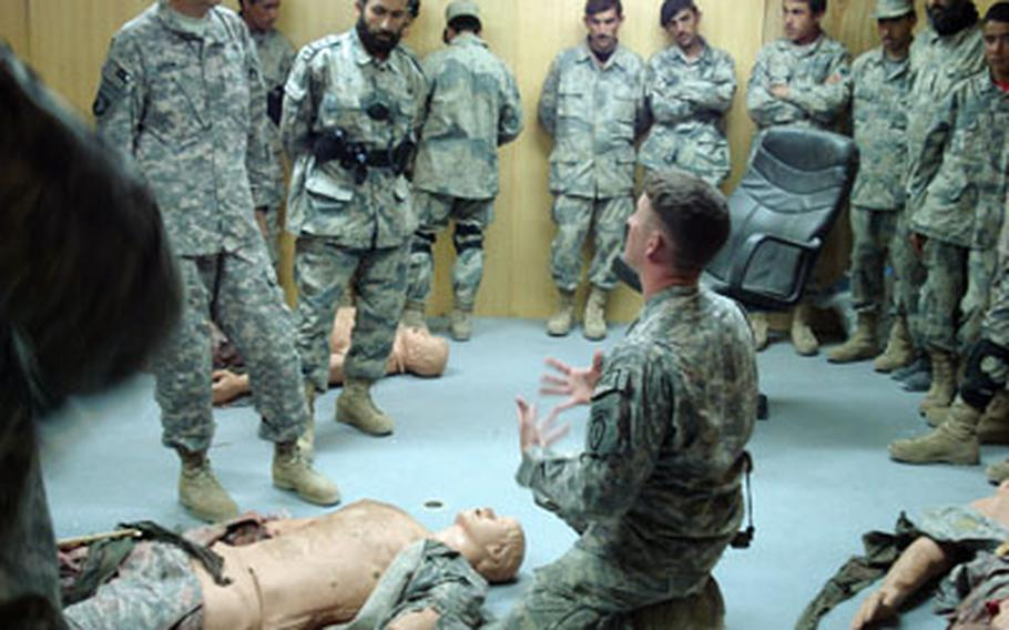The 425th Brigade Special Troops Battalion Medic, Staff Sgt. Robert Green teaches the Combat Lifesaver Class to the Afghan Border Police earlier this year.
