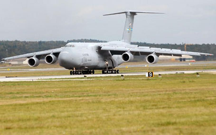 A C-5M Galaxy rolls down the runway after landing at Ramstein Air Base, Germany. The C-5M is an upgraded version of an older model with new avionics and much quieter engines.