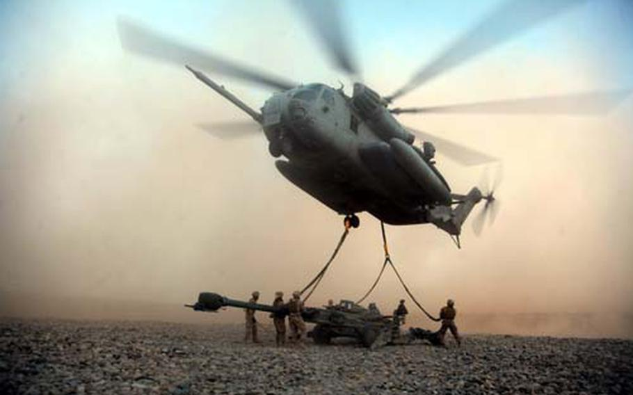 U.S. Marines with Combat Logistics Battalion 8 attach an M777A2 Lightweight Howitzer to a CH-53E Super Stallion at the helicopter landing zone at Fire Base Fiddler's Green in Helmand Province, Afghanistan. The Marines transported three howitzers from 3rd Battalion, 11th Marine Regiment more than 75 miles to support 2nd Battalion, 3rd Marine Regiment's operations in neighboring Nimruz province.