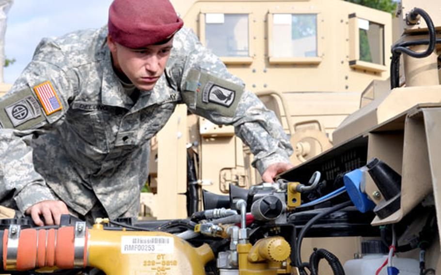 Spc. Levi DeLong takes a look through the engine of the new MRAP All-Terrain Vehicle during training on the new vehicle in Bamberg, Germany, on Tuesday.