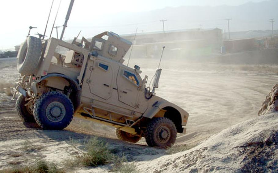 An officer test-drives the new MRAP all-terrain vehicle that is touted as a good alternative to the cumbersome Mine Resistant Ambush Protected vehicles currently being used. The new MATV is designed for easier maneuverability, but some question whether they will be as effective at saving lives.