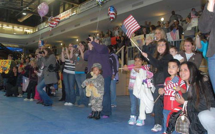 Families welcome soldiers with the 172nd Infantry Brigade back to Grafenwöhr on Monday after their yearlong deployment to Iraq.