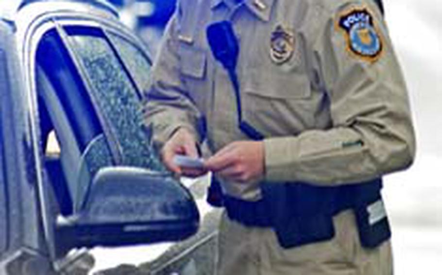 Department of the Army civilian police officer Lt. Shane Kantz, 37, of Richmond, Va., talks to a motorist during a routine traffic stop in Vilseck, Germany, on Friday.
