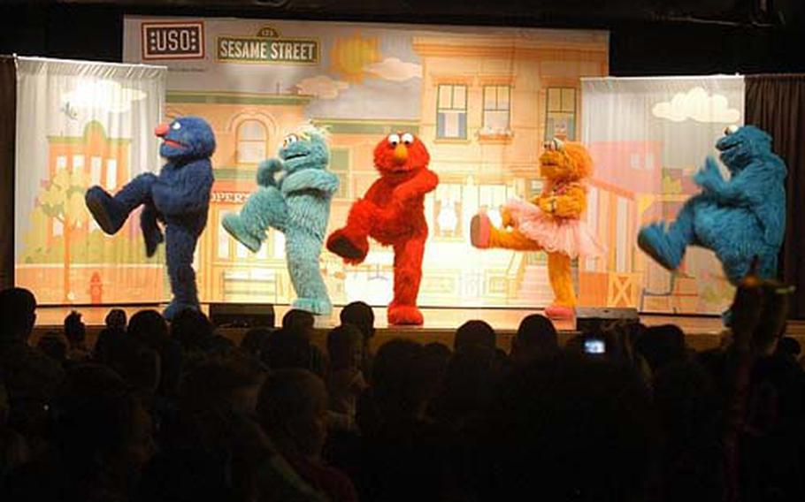 """Characters from """"Sesame Street"""" took some time off from their busy television schedule to entertain families at Aviano Air Base with a half-hour USO show."""