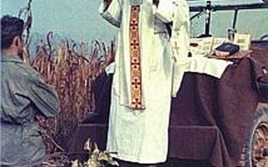 In this undated photo, Father Emil Kapaun, a Catholic priest and Army chaplain, celebrates Mass in the field during the Korean War. Kapaun, already under consideration for sainthood, has won the endorsement of former Army Secretary Pete Geren to receive the Medal of Honor.