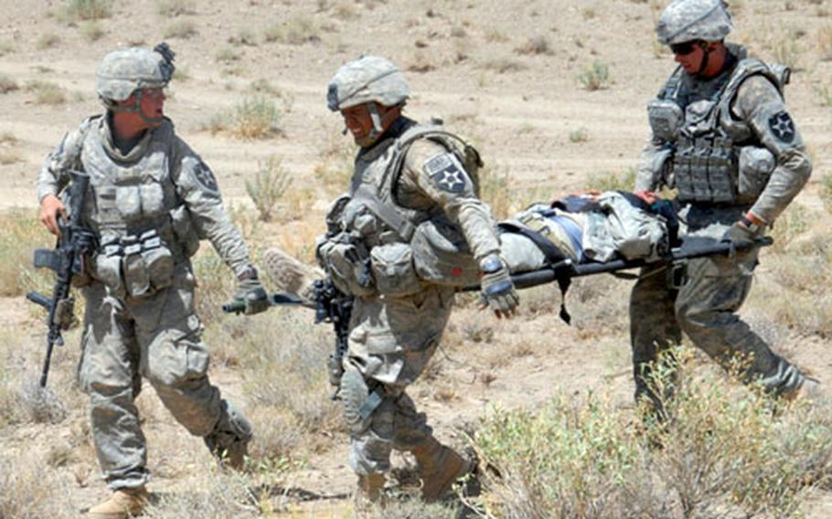 Soldiers from 4th Battalion, 23rd Infantry Regiment, 5th Stryker Brigade Combat Team carry a wounded soldier to be medically evacuated after his vehicle hit an anti-tank mine in Zabul province, Afghanistan, in August. Seventeen Stryker soldiers have died since the unit deployed to Afghanistan in July. The DOD announced this week that the Vilseck, Germany-based 2nd Stryker Cavalry Regiment will replace the 5th Stryker BCT in Afghanistan next summer.