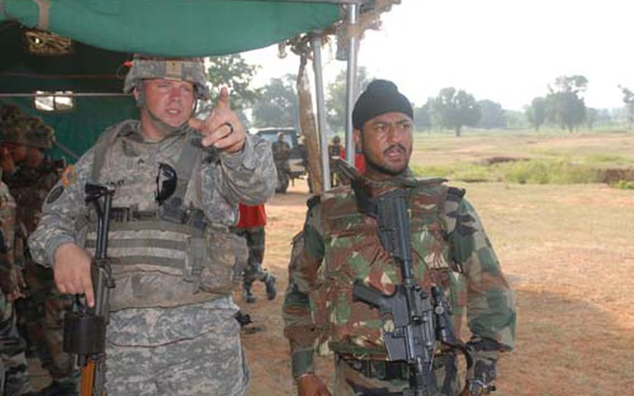 U.S. Army Sgt. John Gentry, left, and Indian Army Lt. Bikram Jit Singh discuss strategy during range training earlier this month at Exercise Yudh Abhyas 09.