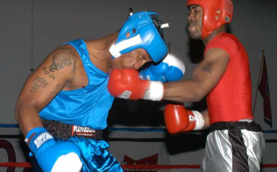 Two servicemembers fight during an August 2007 boxing match at Kunsan Air Base, South Korea.