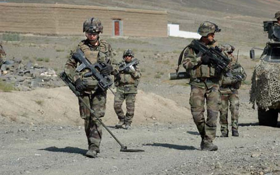French Marine engineers sweep Tagab Valley Road northeast of Kabul in this October 2009 photo. France threaten Friday, Jan. 20, 2012, to withdraw early from Afghanistan after an Afghan soldier killed four French troops and wounded 15.