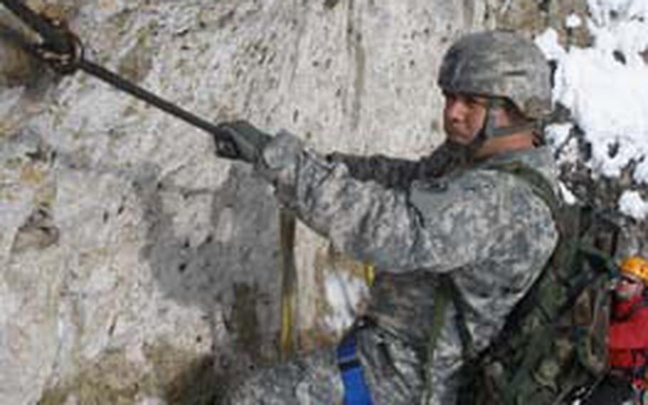 Staff Sgt. Reynaldo Jimenez, with the 2nd Stryker Cavalry Regiment, pulls himself along a cable during a rock-climbing trip in February 2009. The rec center at Grafenwöhr would provide as many of the activities in the Army's Warrior Adventure Quest program as possible.