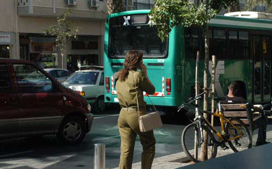 Israeli troops are a visible presence throughout Tel Aviv and Jerusalem -- including female soldiers with their hair in a ponytails and their uniforms tailored to fit just so.