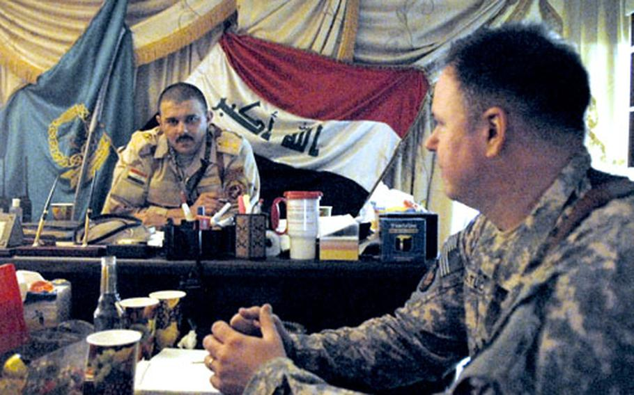 Iraqi Army Col. Abbas Fadhil Sahib has tea with U.S. Army Lt. Col. Douglas Boltuc. Abbas has won wide praise from U.S. military advisers since taking command of Iraq's premier military training center in 2006. His relations with his own superiors, however, have been more problematic.