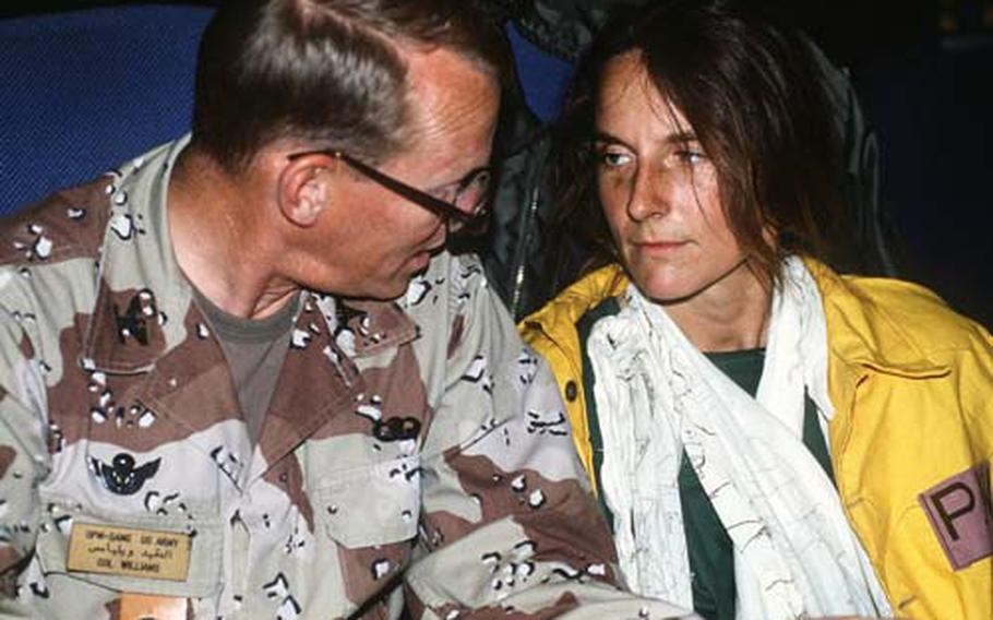 Then-Maj. Rhonda Cornum, a flight surgeon assigned to the 2nd Battalion, 229th Aviation Brigade, sits next to U.S. Army Col. Richard Williams on a C-141B Starlifter transport aircraft after her release by the Iraqi government during Operation Desert Storm in 1991. Cornum was held for eight days as a prisoner of war.