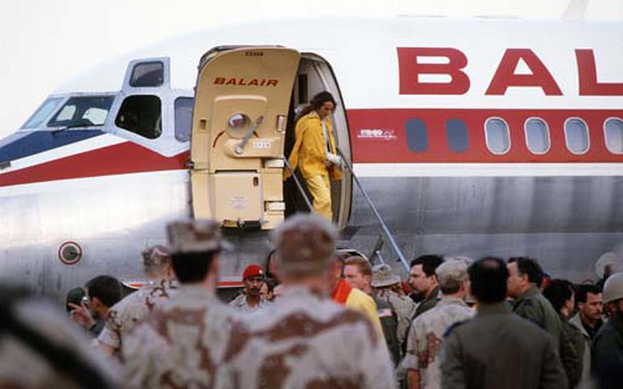 Maj. Rhonda Lee Cornum disembarks an International Red Cross DC-9 aircraft from Geneva at the Riyadh Air Base upon her release by the Iraqi government during Operation Desert Storm.