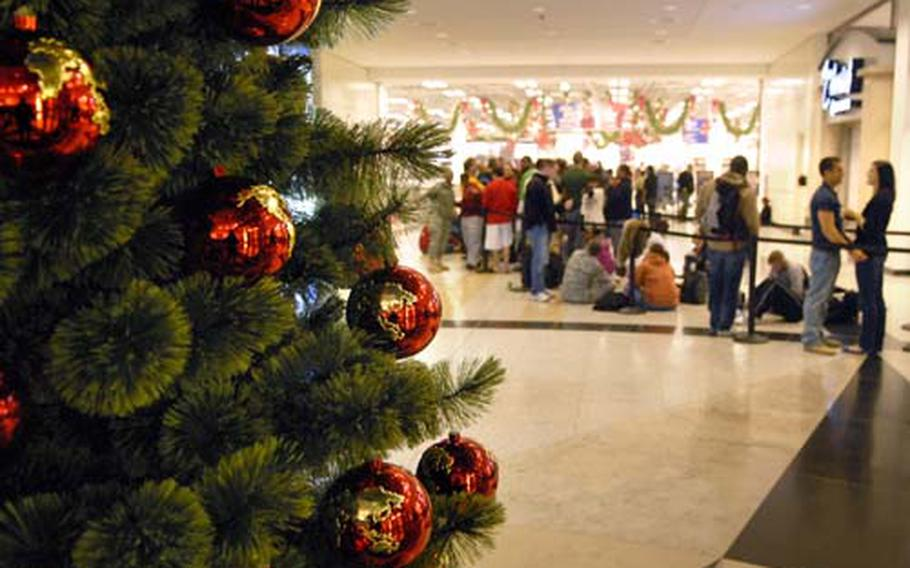"""Shoppers line up out side of the Kaiserslautern Military Community Center Base Exchange, Nov. 27, 2009 for """"Black Friday"""" deals on Ramstein Air Base, Germany. The exchange is on pace for $18.5 million in sales in December, which is a 24 percent increase from the five facilities it replaced in the Kaiserslautern region."""