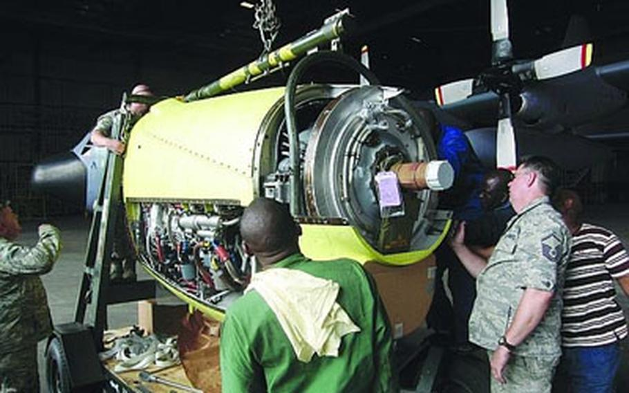 Master Sgt. Jim Goostree examines the engine from a Nigerian C-130 as part of an effort to restore the aircraft to flying condition. Once able to fly, the plane will go to a repair depot in Europe for a more extensive overhaul. The 17th Air Force (U.S. Air Forces Africa) and the West African nation are involved in several military-to-military projects. Goostree is a member of the Tennessee Air National Guard's 118th Airlift Wing.