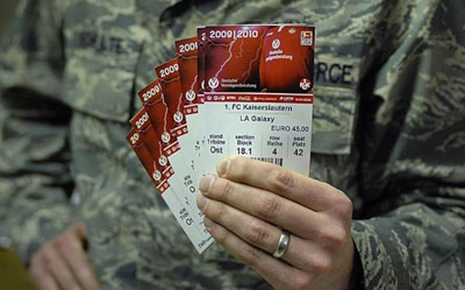 Air Force Capt. Nick Schulte shows his seven Galaxy tickets he purchased for 45 Euro each.