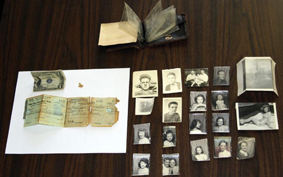 Several photos and a money order were among the items found in a dusty old wallet in the attic of a barracks building in Ansbach, Germany, last spring. The wallet and its owner, who was stationed in Ansbach in the 1940s, were reunited last summer.