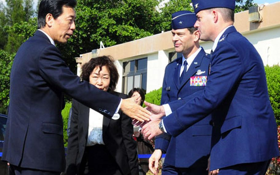 Japan chief cabinet secretary Hirofumi Hirano, left, meets Gen. Ken Wilsbach, 18th Wing commander, second from right, and Col. Lenny Richoux, 18th Wing vice commander, right, at Kadena Air Base, Okinawa, on Saturday.