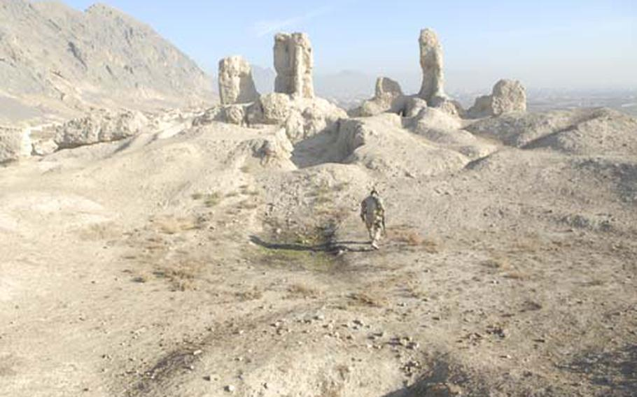 A Canadian soldier walks on top of a fortress on the outskirts of Kandahar that locals claim was built by Alexander the Great. The soldier, who goes only by Sgt. Tom for security reasons, was leading a community patrol with the Kandahar Provincial Reconstruction Team aimed at reaching out to local Afghans.