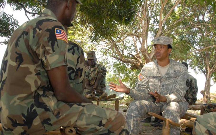 Sgt. 1st Class Shanwte Reynolds, 39, of Flint, Mich., a U.S. Africa Command NCO, discusses leadership with soldiers from the Armed Forces of Liberia during a recent mentorship session at Edward Binyah Kesselly Military Barracks near Monrovia.