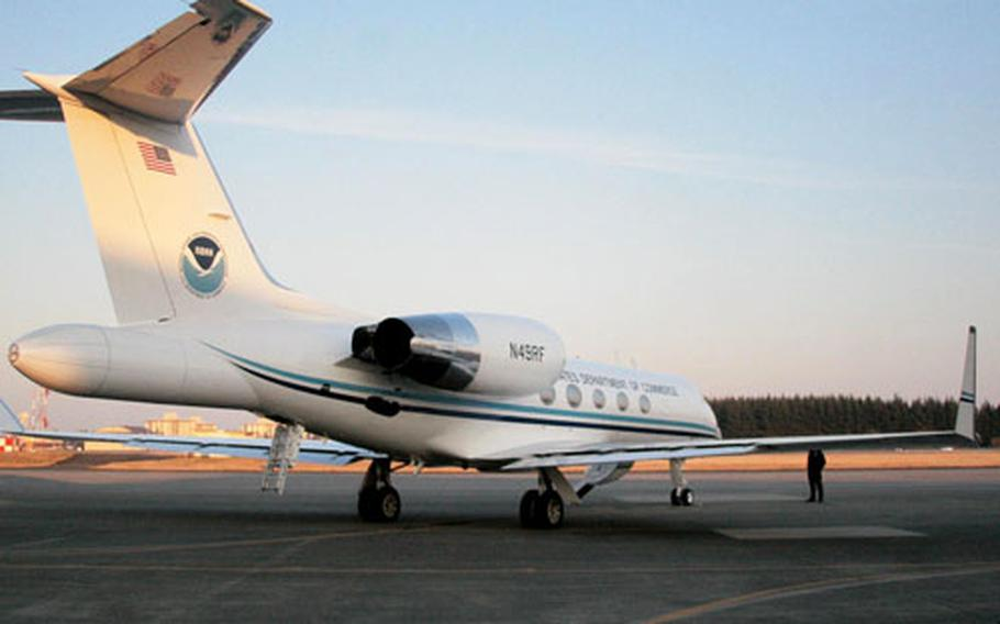 NOAA's Gulfstream IV prepares for take-off Tuesday at Yokota Air Base, Japan. The jet is used to help gauge storms and improve weather forecasts, and will provide forecasting data for the upcoming 2010 Winter Olympics in Vancouver.