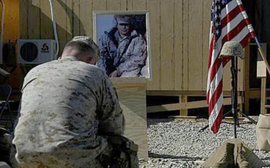 Gen. Larry Nicholson, commander of Marine Expeditionary Brigade-Afghanistan, mourns during a memorial for a Marine killed earlier this month in Helmand province. Lance. Cpl. Mark Juarez was killed Jan. 9, marking the second KIA for the 1st Battalion, 3rd Marines since they arrived in Nawa in December.